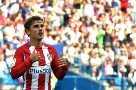© AFP/Archives | Antoine Griezmann célèbre un but, le 17 septembre 2016 lors du match Atlético Madrid - Gijon au stade Vicente-Calderon.