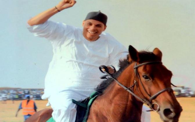 "Karim Wade ""hésite"" à rentrer au Sénégal"
