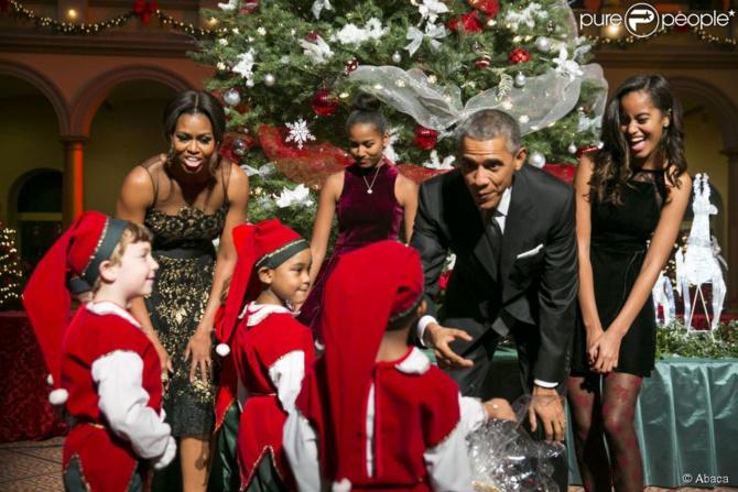 Le président Barack Obama, son épouse Michelle et leurs filles Malia et Sasha lors de l'enregistrement du concert Christmas in Washington à Washington, le 14 décembre 2014  © Abaca