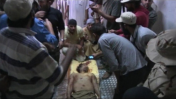 Le corps de Kadhafi inhumé mardi en plein désert
