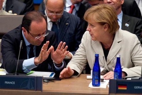 Hollande et Merkel tentent d'aplanir leurs divergences