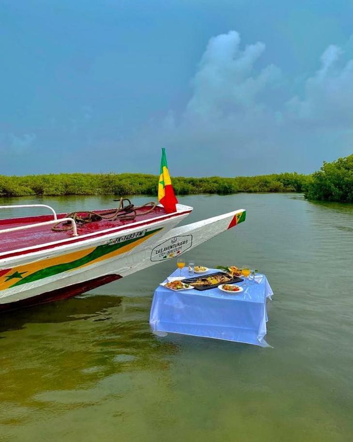 PHOTOS - Waly Seck et Sokhna Aïdara aux îles du Saloum: Les deux tourtereaux profitent de l'hivernage
