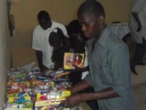 L'association Jeunesse Engagée et Responsable de Saint-Louis distribue 310 lots de fournitures aux enfants démunis