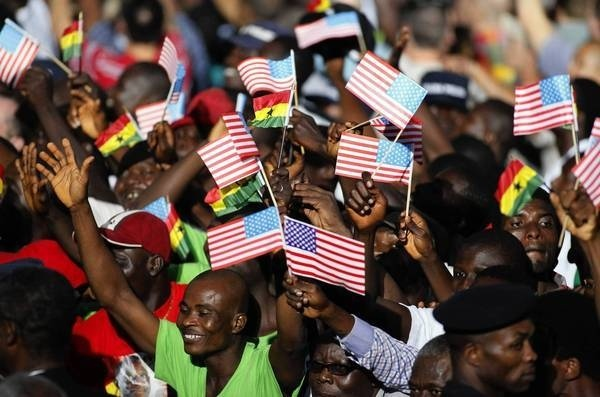 People in Accra, Ghana, cheer during a departure ceremony for President Obama after his visit in July 2009. (Rebecca Blackwell, Associated Press / July 11, 2009)