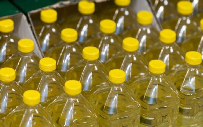 Voie de contournement tarifaire: De l'huile en vrac reconditionnée dans des bouteilles