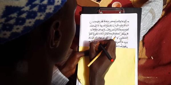 [VIDEO] Un exemplaire du Saint Coran écrit en une journée à Touba. Regardez!