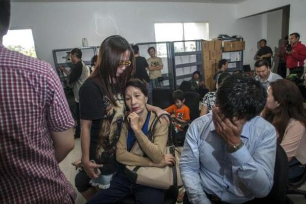 Une famille de dix personnes a raté le vol fatal d'Air Asia