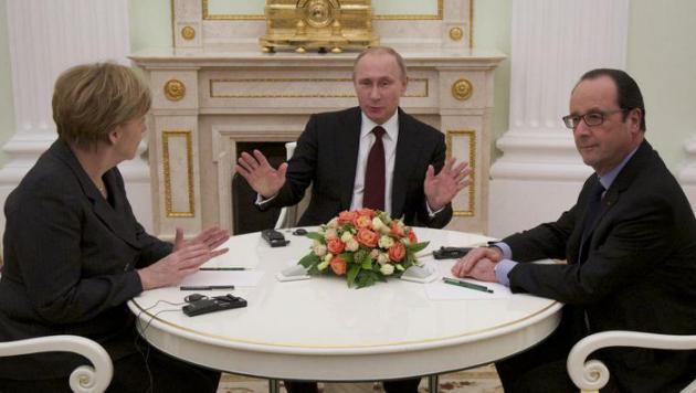 Hollande et Merkel en mission de paix au Kremlin