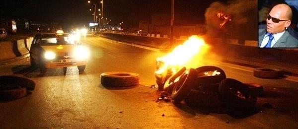 Karim Wade condamné à six ans de prison, les libéraux brûlent des pneus sur la Corniche