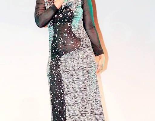 La chanteuse GuiGui plus sexy que jamais avec ses robes transparentes