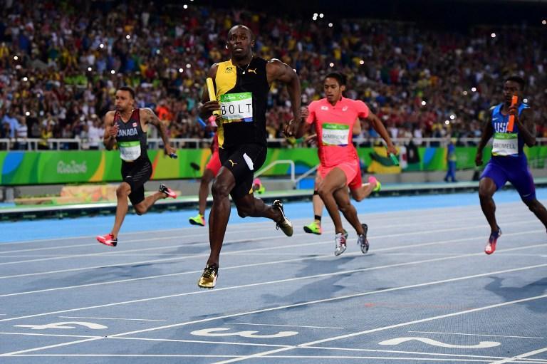 """Usain Bolt réussit le """"triple triplé"""" : La légende continue !"""