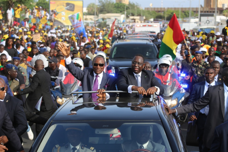 Que cherche Alpha Condé à Dakar ?