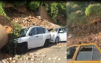 Vidéo - Lagon 1: Des voitures en miettes sous les décombres de...
