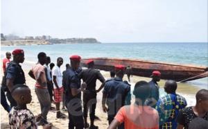 Photos : les images de la pirogue des migrants qui à échoué au large de la porte du Millénaire
