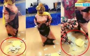 """VIDEO -""""Battré"""" spectaculaire: Une Gambienne gâte Mère Dial avec plusieurs liasses de billets"""