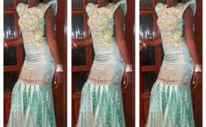 Queen Biz rayonnante dans une somptueuse robe