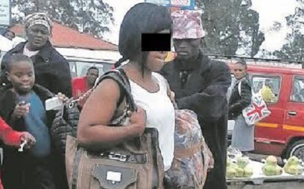 (PHOTO)-Une femme à moitié nue provoque un tollé dans une gare de taxis