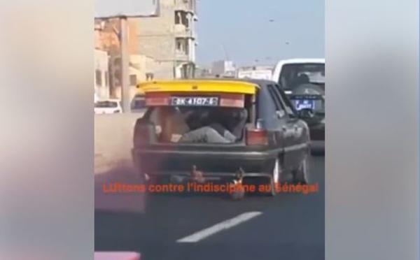 VIDEO - INDISCIPLINE: Des personnes transportées dans le coffre d'un taxi en plein jour, regardez