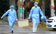 Coronavirus: la Chine confine des villes et ferme la Cité interdite